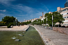 Row of houses and a fountain. A residential neighbourhood with buildings in a row and a fountain Stock Image