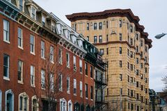 Row houses and a historic highrise building, in Mount Vernon, Baltimore, Maryland.  royalty free stock photo
