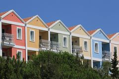 Row of houses in loud colors. On a cliff royalty free stock photo