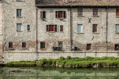 Row of houses and Metauro river Stock Photography