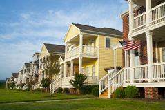 Row of Houses in a Mid-America Suburb. An Neighborhood. One house flies an American Flag Royalty Free Stock Photography