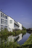 Houses next to river. A row of houses next to a river Royalty Free Stock Images