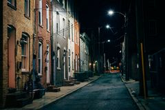Row houses at night, in Fells Point, Baltimore, Maryland.  stock photo