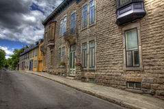 Row of Houses with Road. A row of houses attached along a paved road Royalty Free Stock Photos