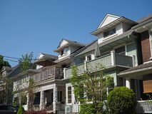 Row of houses. With dormer windows and large porches Royalty Free Stock Photo