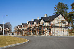 Row of houses with scaffolds Stock Image