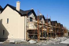 Row of houses with scaffolds Royalty Free Stock Image
