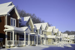 Row of Houses with Snow. A row of gabled houses with snow on roofs and at front Stock Photo