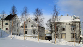 Row of Houses in Snow. Photo taken in the morning after overnight snow, at Tromso, Norway Royalty Free Stock Images