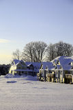 Row houses after snow storm. A row of houses covered with snow, taken in the morning Royalty Free Stock Photo