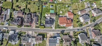 row of houses on a street in Germany, detached houses with gardens, aerial photo stock photography