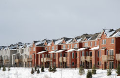 Row of houses in winter. Row of houses in a winter setting royalty free stock image