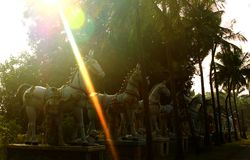 The row of indian horse brave man village god statue with sun rays. Stock Images