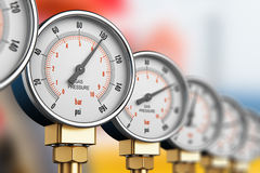 Row of industrial high pressure gas gauge meters Stock Images