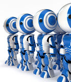 Row of Industrial Robots to Replace Human Workers Royalty Free Stock Images