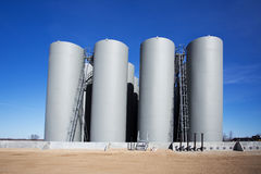 Row of industrial storage tanks Royalty Free Stock Photo