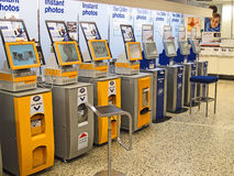 A row of instant photo kiosks in a store. Royalty Free Stock Photo