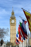 Row of International Flags in front of Big Ben. Row of International Flags in front of Iconic Big Ben Clock Tower, Palace of Westminster, London, England Stock Photo