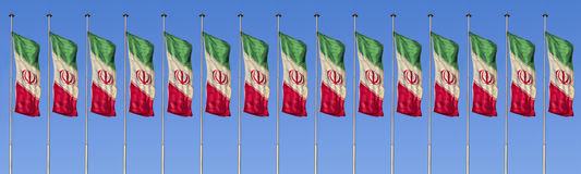 Flag of iran. A row of Colorful flag of iran isolated against blue sky background in a windy day royalty free stock photos
