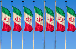 A row of Iran flag. A row of Colorful iran flag isolated on blue sky background Stock Images