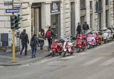 A row of Italian scooters Vespa in the streets of Rome in Italy. Royalty Free Stock Photography