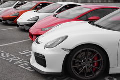 Row of Italian sports cars. In red and white Stock Photography