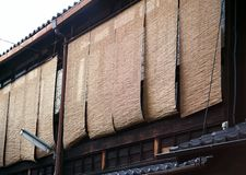 Row of Japanese old traditional window wooden curtains stock image