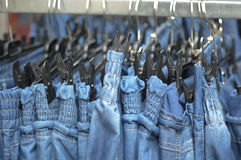 Row of jeans trousers on sell Stock Photography