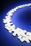 Row of Jigsaw Puzzle Pieces. On Blue Background Stock Images