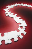 Row of Jigsaw Puzzle Pieces Stock Images