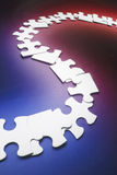 Row of Jigsaw Puzzle Pieces Stock Photo