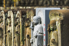 Row of jizo statues. Tokyo, Japan - April 06, 2015: Row of Jizo statues at Jomyo-in temple in Tokyo.  The temple is famous for having over 84.000 `jizo` guardian Royalty Free Stock Images