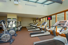 Row of jogging simulators in gym Stock Image
