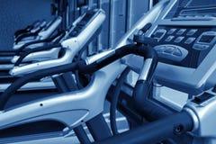 Row of jogging simulators, monochromatic Stock Photography