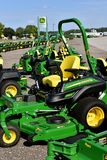 Row of John Deer riding lawn mowers. HAWLEY, MINNESOTA, August 22, 2017: The green and yellow riding lawn mower tractors are products of John Deere Co, an Stock Photography