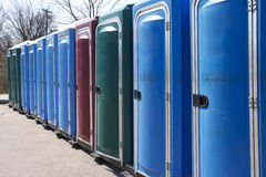 Row of Johns. Colorful row of port-o-potties at a public event stock photos
