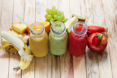Row Juice Smoothie Bottles Red Green Orange Fruits Royalty Free Stock Image