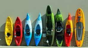Row of kayaks for sale Stock Photo