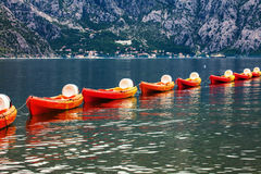 Row of kayaks in the sea Stock Image