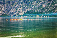 Row of kayaks in the sea Stock Photos