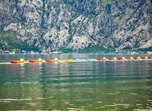 Row of kayaks in the sea Royalty Free Stock Images