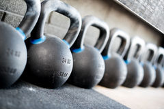 Row of kettlebell or girya weights in a gym royalty free stock photography