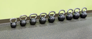 Row of Kettlebells at Fitness Center Stock Photography