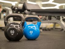 Row of kettlebells in a modern gym royalty free stock images
