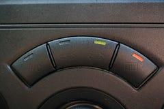 Row of knobs on a car dashboard. Stock Photos