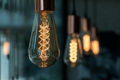 Row of lamps lighting near window of coffee shop Royalty Free Stock Photos