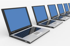 Row of Laptops with blue screen Royalty Free Stock Image