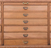Row of large drawers with empty tags Royalty Free Stock Photos
