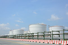 Row of large white tanks for petrol and oil. In Thailand Stock Photos