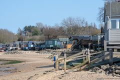 Row of large wooden beachside homes on beach royalty free stock images